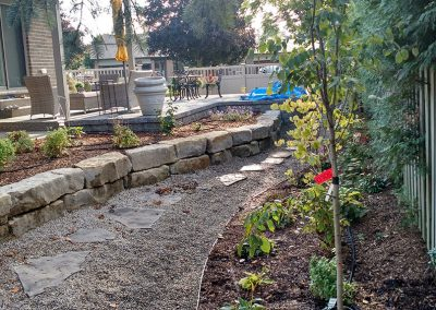 Hardscaping - walkway with stepping stones and armour stone retaining wall