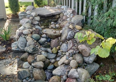 Pondless waterfall using rock and flagstone