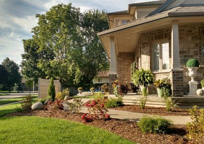 Adding natural elements to exposed corner lot enhances curb appeal and privacy