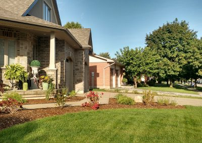 Adding softscaping in landscape design for exposed corner lot enhances curb appeal