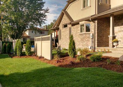 Mixing hardscaping and softscaping in landscape design for exposed corner lot enhances curb appeal and privacy
