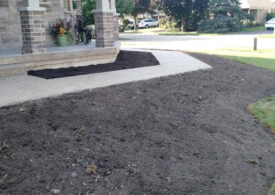 Flower beds surround corner lot home for enhanced curb appeal