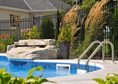 Landscaping and waterfall in pool area