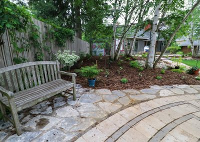 Sitting area beside Stone Labyrinth by A Touch of Dutch Landscaping