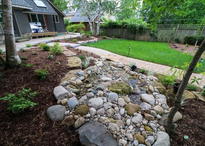 Pondless stream and raised stone patio