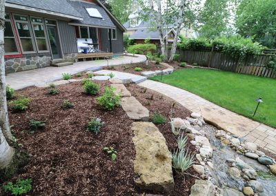 Terraced flower bed and raised stone patio