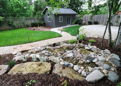Pondless stream with natural stone and stone garden pathway