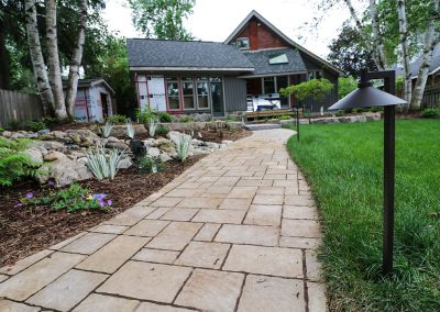 Stone walkway with terraced flower beds