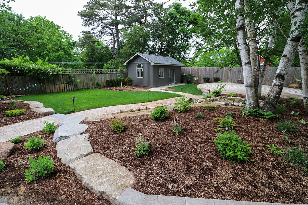 Stone labyrinth, patio, and walkway by A Touch of Dutch Stratford