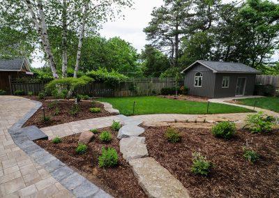 Armour stone creates terraced flower beds