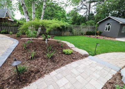 Perennial gardens with interlocking brick walkway