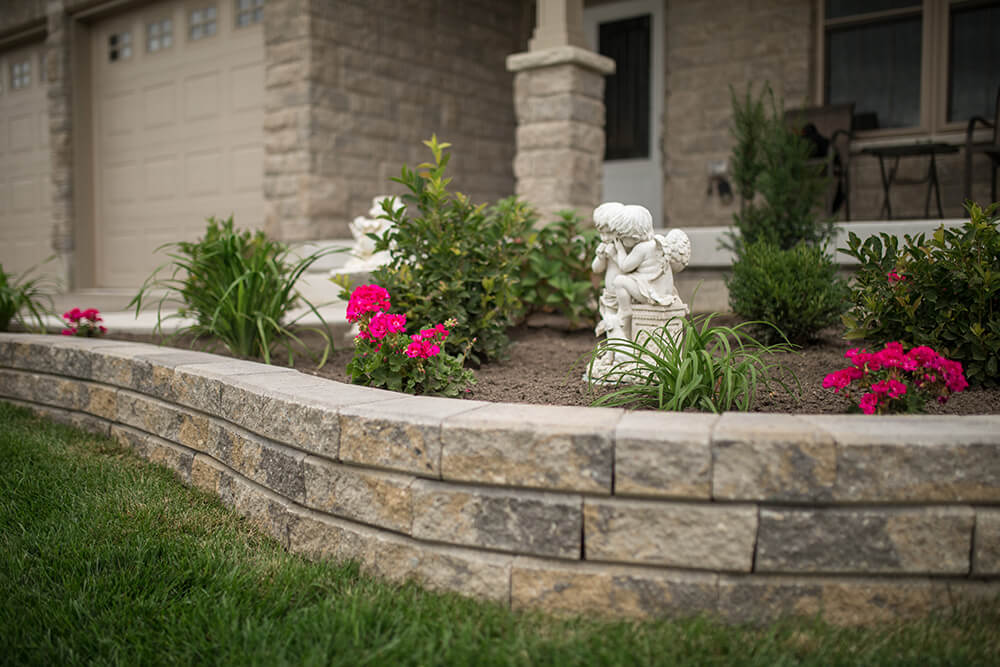 Raised flower bed with brick retaining wall