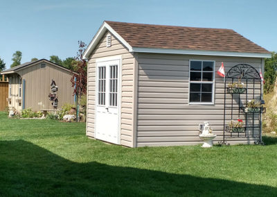 Backyard shed needs flower bed and colour