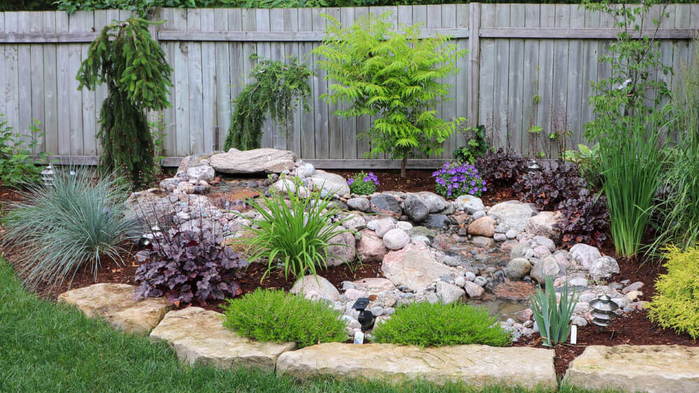 Pondless waterfall, natural stone and garden Installation