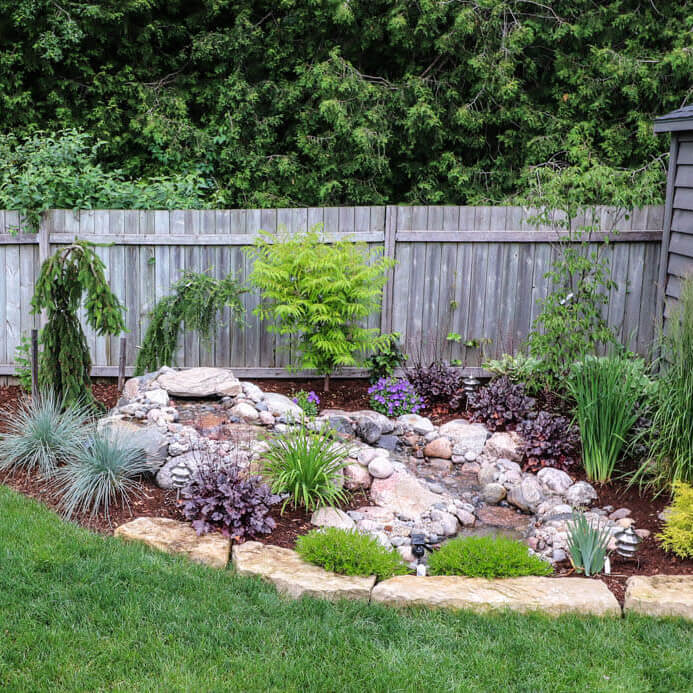 Pondless stream, natural stone and garden Installation