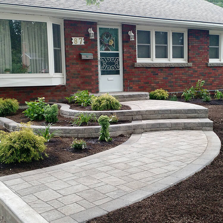 raised flower beds gardens natural stone curved walkway pavers retaining walls perennials shrubs