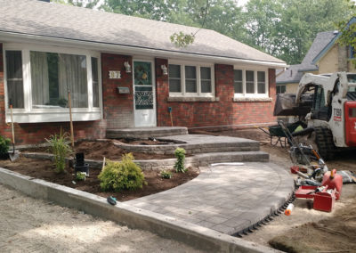 curb appeal raised flower beds gardens natural stone curved walkway pavers retaining walls perennials shrubs